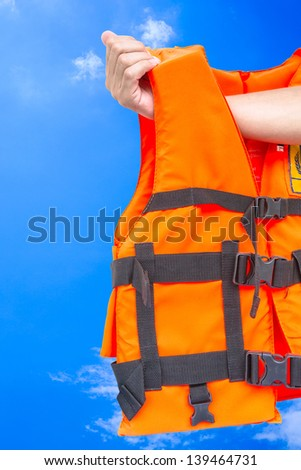 life jacket with hand on blue sky
