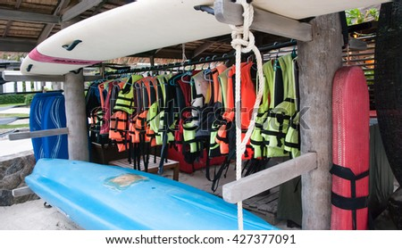 Life jackets for a swim in the sea and equipment for rescue - stock photo