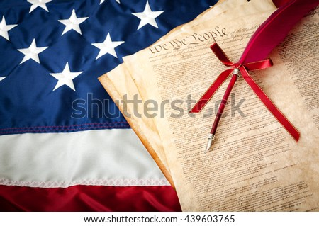 Life, Liberty, the pursuit of Happiness. The American flag, the US constitution and a fountain pen, can be used for 4th of july or any other patriotic holiday. Land of the free and home of the brave