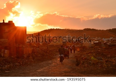 Life of Chinese People in Ancient Village at Sunset