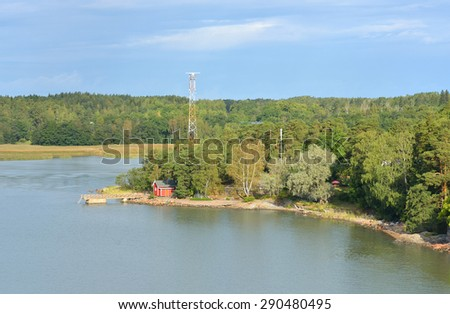 Life on small island. Red house on rocky shore of Baltic Sea. Turku, Finland - stock photo