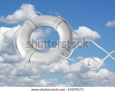 life preserver being tossed in summer sky - stock photo