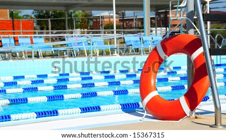 Life preserver by lanes in public swimming pool