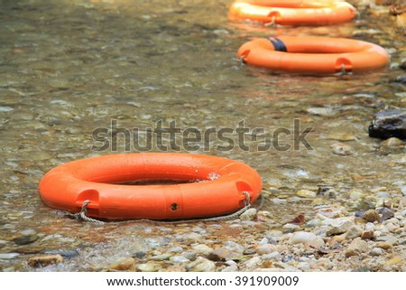 life preserver float  in the river - stock photo