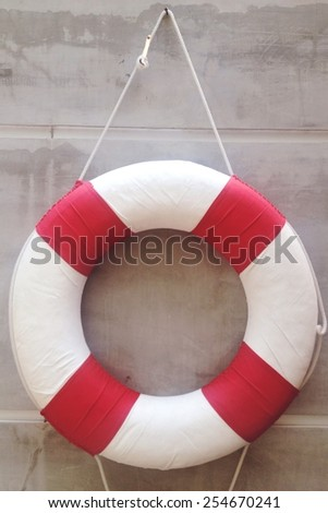 life preserver on a wall - stock photo