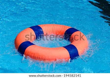 Life preserver on swimming pool. - stock photo