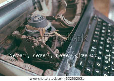 Life Quote. Quote photo on a typewriter background. Never, never, never give up