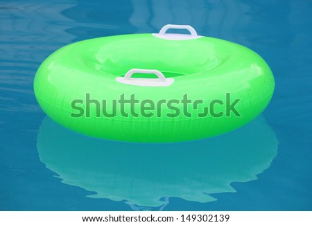Life ring floating on blue water. - stock photo
