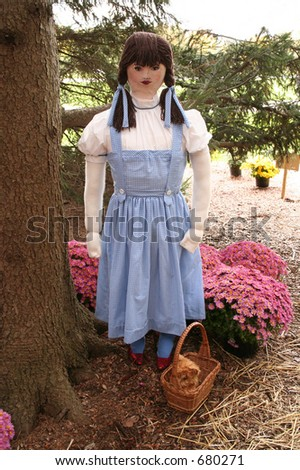 Life size figure in a blue pinafore - stock photo