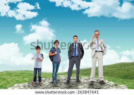 Life stages of businessman against field and sky - stock photo