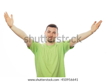 life style  and people concept: casual young man in shirt  with both hands raised in the air. Winner and happy. - stock photo