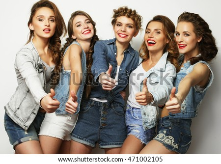 life style and people concept: Fashion portrait of five stylish sexy girls best friends
