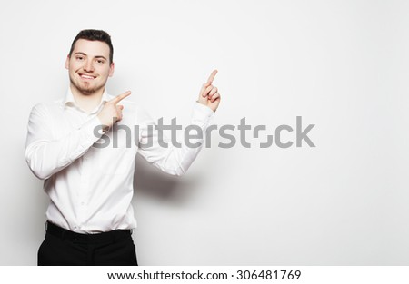 life style, business  and people concept: business man points with fingers in the right side over white background. - stock photo