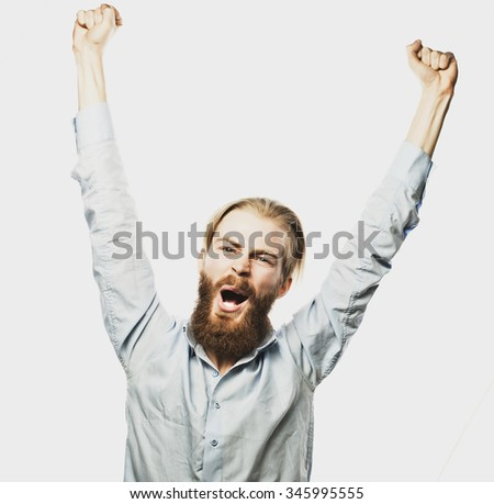 life style, happiness and people concept: young positive  bearded man showing hand up standing against grey background.