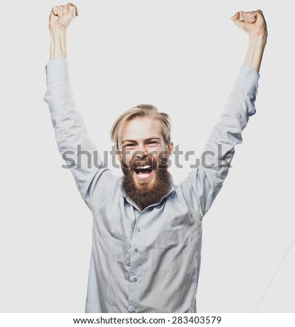 life style, happiness and people concept: young positivity  bearded man showing hand up standing against grey background. - stock photo