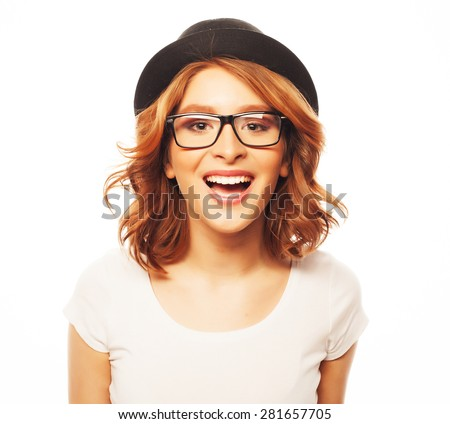 life style, happiness, emotional  and people concept: Beautiful young  woman wearing black hat and eyeglasses looking at camera and make different emotions while standing against white background - stock photo