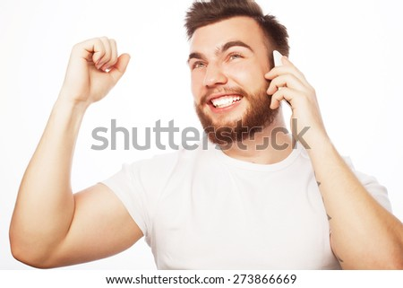 life style, tehnology  and people concept:  cheerful man on the phone with fist raised receiving good news. - stock photo
