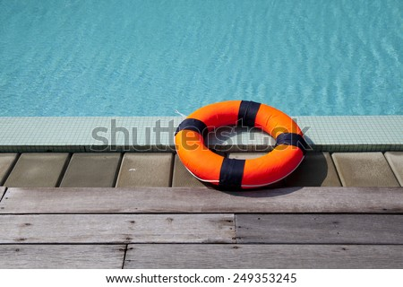 lifebelt at the pool - stock photo