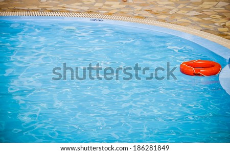 Lifebelt. Holidays hotel swimming pool. - stock photo