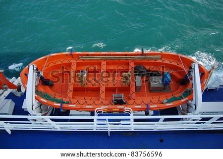 Lifeboat from Above Orange ferry lifeboat taken from above. - stock photo