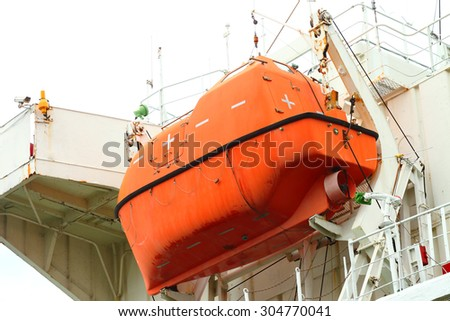Lifeboat hanging on a deck of vessel.  - stock photo