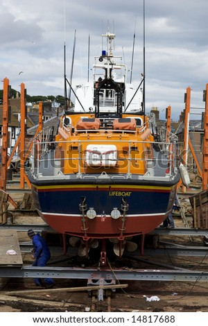 Lifeboat in Scottish harbour - stock photo