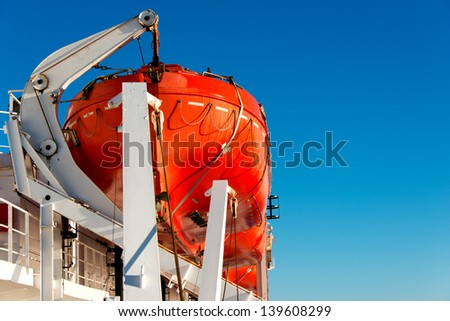 Lifeboat on a cruise ship close up - stock photo