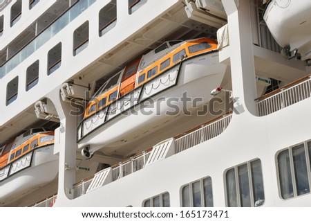 Lifeboat on a davit at a modern cruise ship - stock photo