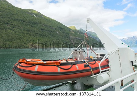 Lifeboat on a ship - stock photo