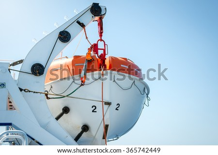 Lifeboat on deck of a cruise ship - stock photo