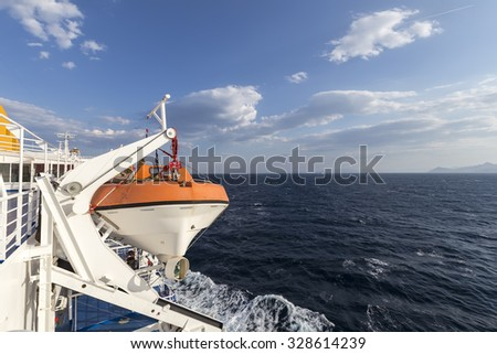 Lifeboat on the port side of the ship - stock photo