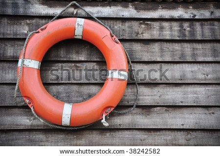 Lifebuoy Attached to a Wall - stock photo