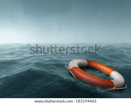 Lifebuoy floating in the vast expanse of sea - stock photo