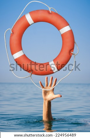 Lifebuoy for drowning man's hand in open sea or ocean water. - stock photo