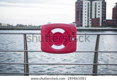Lifebuoy hanging on fence