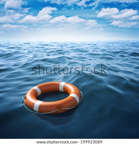 Lifebuoy in blue sea - stock photo