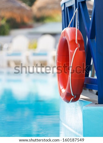 lifebuoy in hotel pool - stock photo