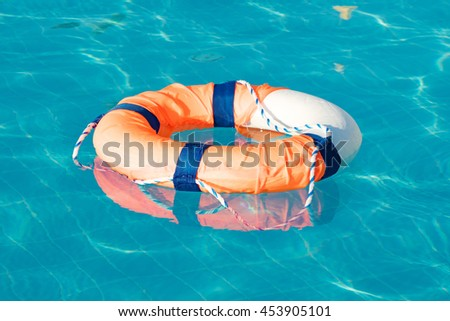 lifebuoy in pool - stock photo