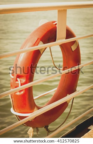 Lifebuoy on board. Close-up view. Retro toned image. - stock photo