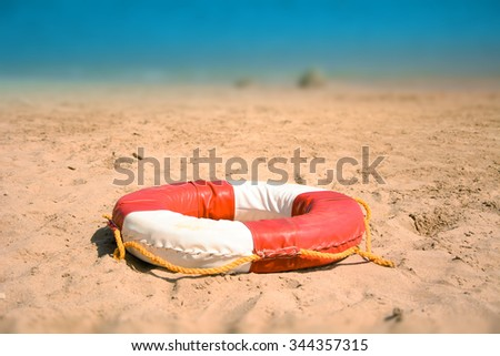 Lifebuoy On Sandy Beach - stock photo