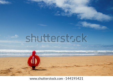 Lifebuoy on sea background. - stock photo