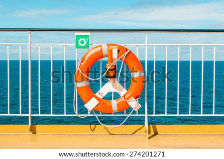 Lifebuoy on the deck of cruise ship - stock photo