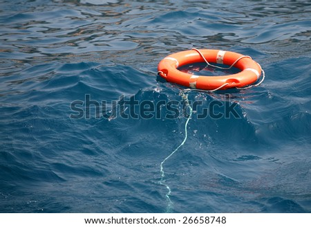 Lifebuoy on the water - stock photo