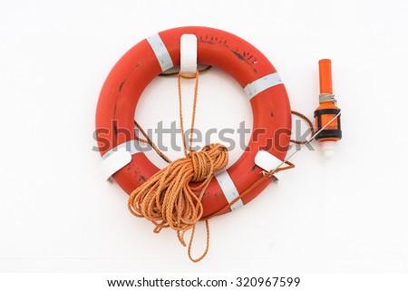 Lifebuoy on white wall - stock photo