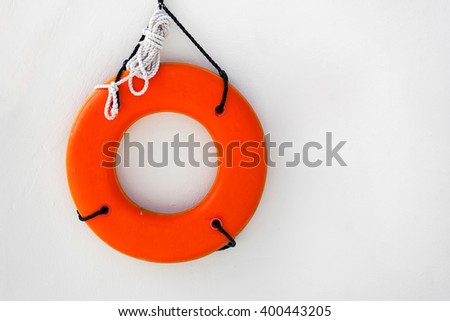 Lifebuoy ring near swimming pool at luxury resort - stock photo