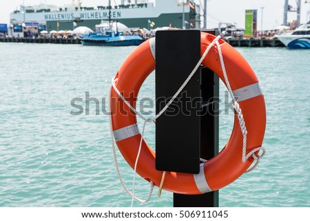 Lifebuoy suspended in port