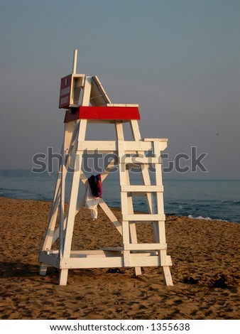 Lifeguard chair on beach - stock photo