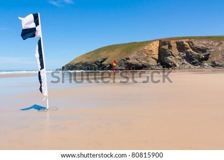 Lifeguard flags on the beach at Mawgan Porth near Newquay Cornwall England - stock photo