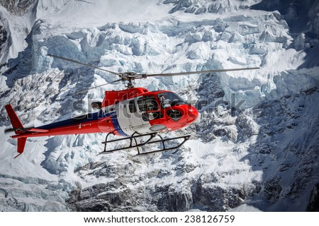 Lifeguard helicopter on Everest base camp in Nepal - stock photo