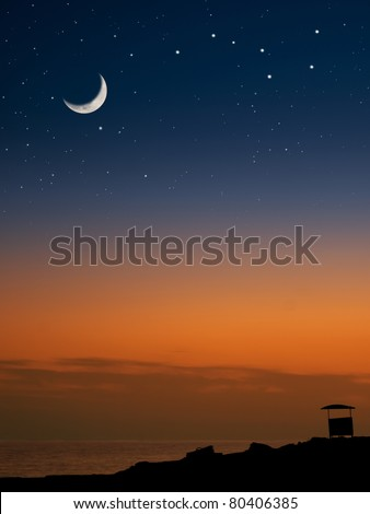 lifeguard house on the beach at the sunset with the Moon and the stars, for tourism,astronomy,nature themes - stock photo